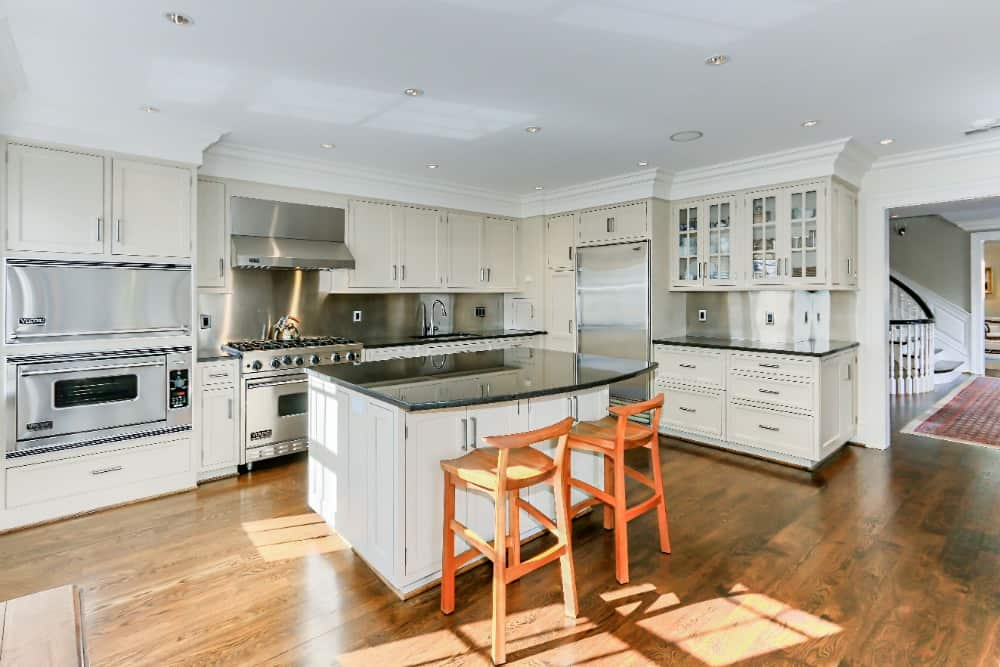 The kitchen is quite spacious and has a center island with a black countertop and has space for a breakfast bar. Images courtesy of Toptenrealestatedeals.com.