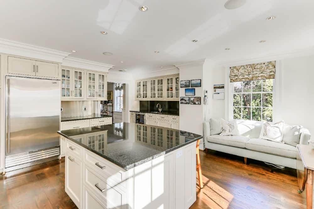 A closer look at the kitchen's square-type center island with a black granite countertop. Images courtesy of Toptenrealestatedeals.com.