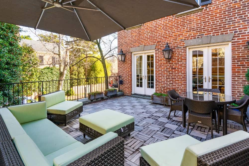 The patio offers a cozy set of seats along with an outdoor dining table set. Images courtesy of Toptenrealestatedeals.com.