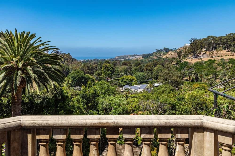 A look of the gorgeous nature surrounding the property from one of the private balconies. Images courtesy of Toptenrealestatedeals.com.