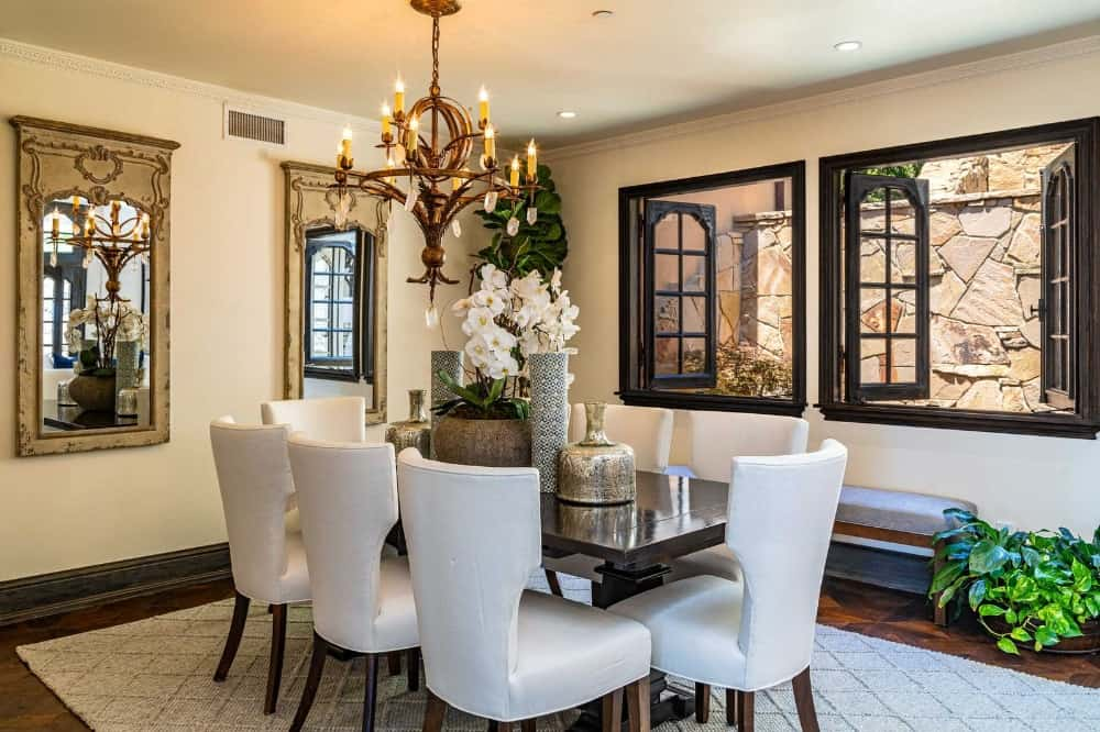 Here's one of the dining rooms featuring a small rectangular table paired with gorgeous white chairs set on top of an area rug. Images courtesy of Toptenrealestatedeals.com.
