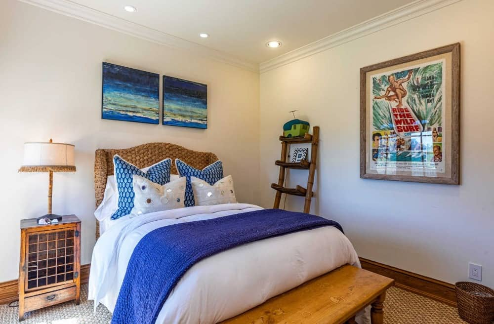 This bedroom suite offers a nice bed set lighted by a table lamp on the side. The room features artistic wall decors too. Images courtesy of Toptenrealestatedeals.com.