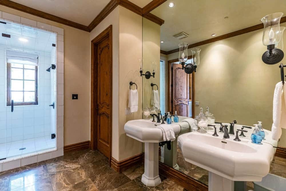 A closer look at this bathroom's two pedestal sinks. There's a walk-in shower room as well. Images courtesy of Toptenrealestatedeals.com.
