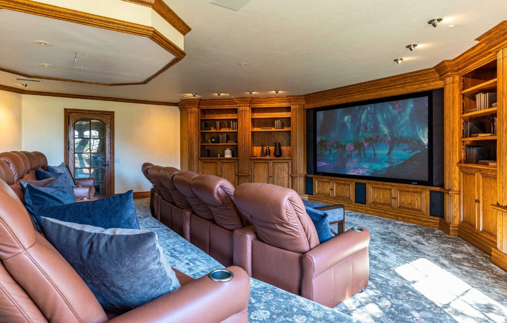 Another look at the home theater showcasing the brown leather sectional seats and the large theater-style TV. Images courtesy of Toptenrealestatedeals.com.