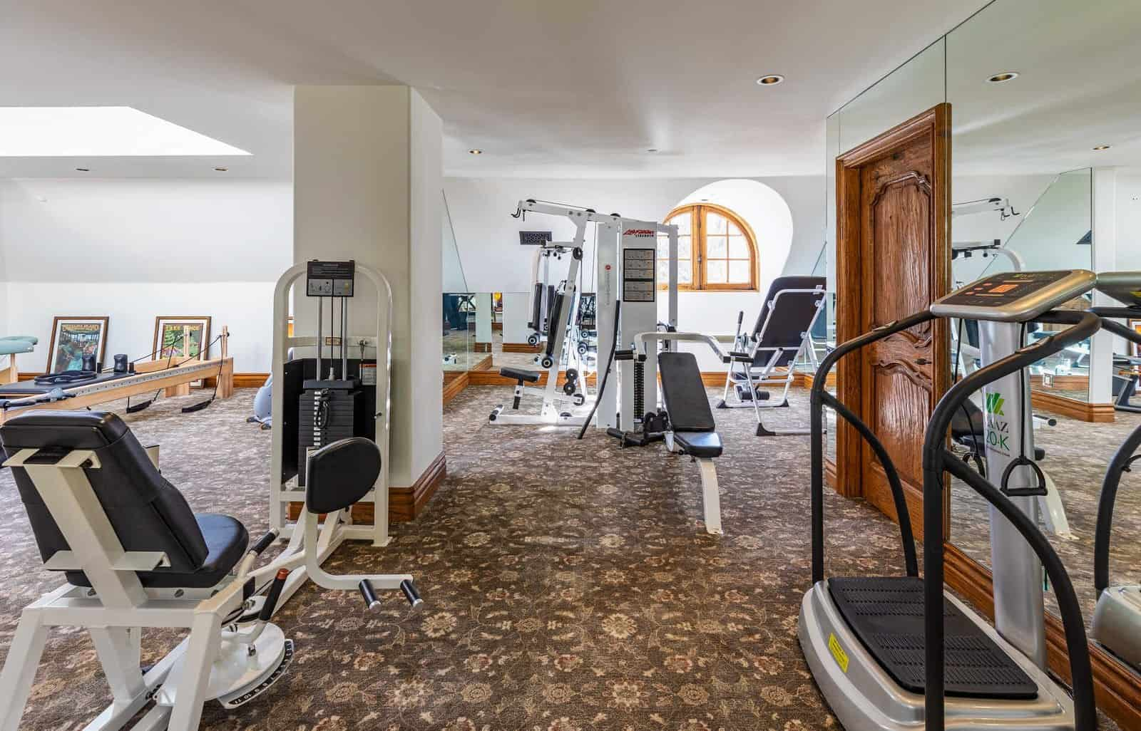 The home also offers a large home gym with lots of great fitness equipment. The room also features carpet flooring. Images courtesy of Toptenrealestatedeals.com.