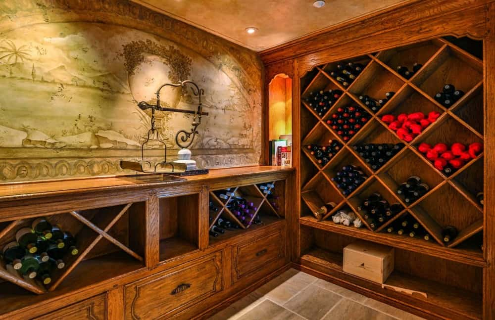 There's a wine cellar as well featuring many stylish wine racks and elegantly decorated walls. Images courtesy of Toptenrealestatedeals.com.