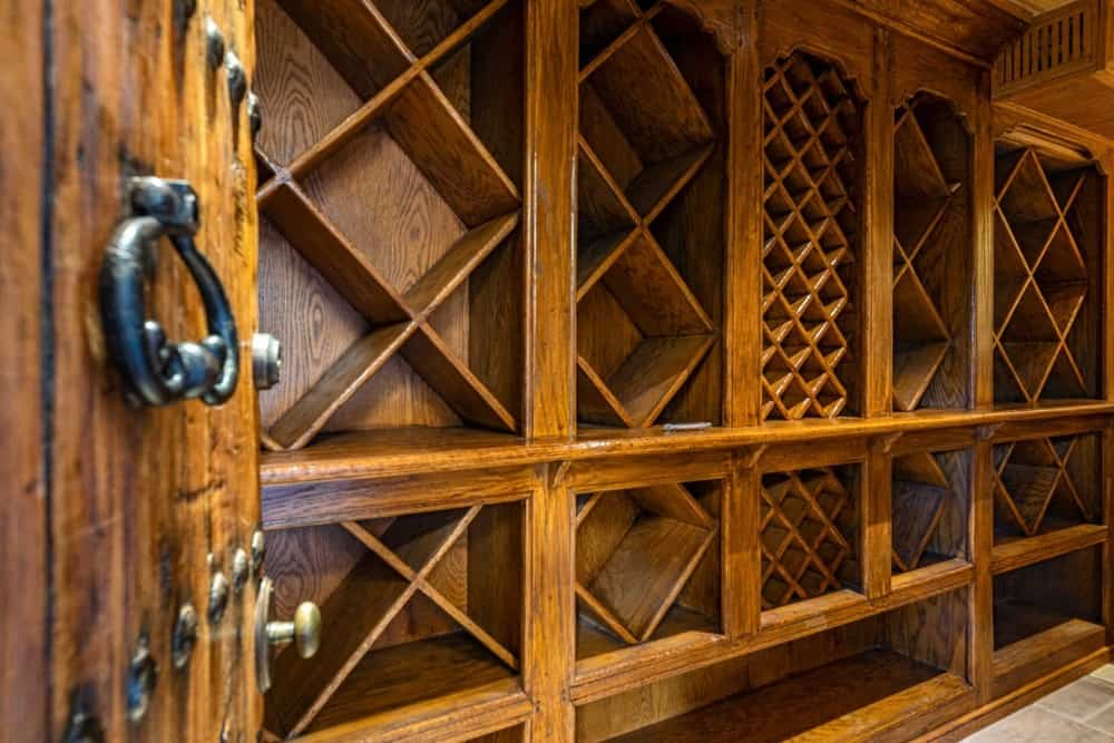 A closer look at the empty wine racks inside the wine cellar. Images courtesy of Toptenrealestatedeals.com.