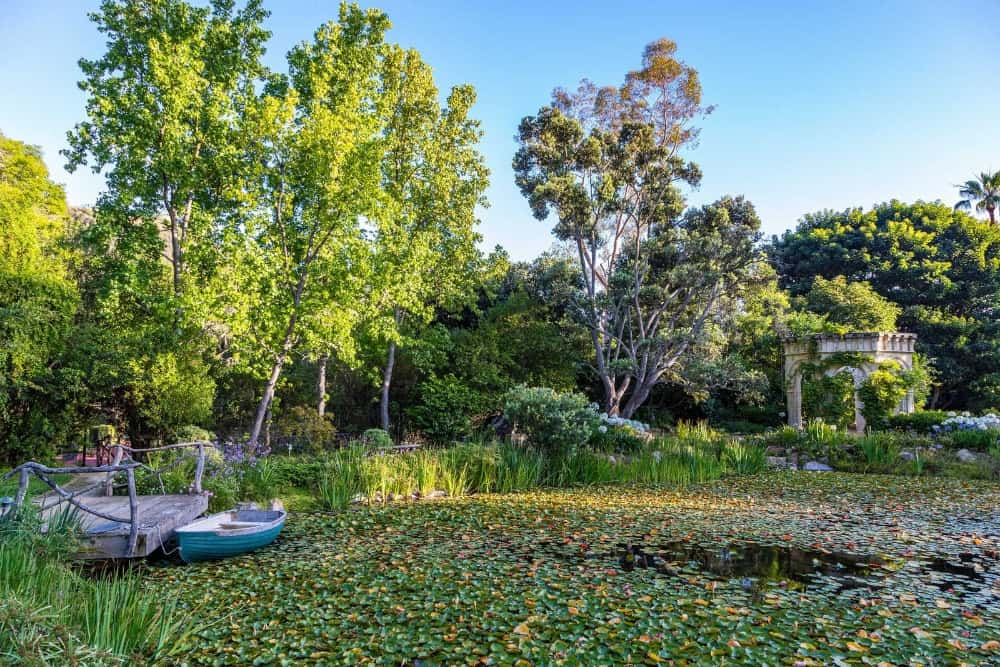 There's a small dock in the backyard as well featuring a small boat to explore the small area of water. Images courtesy of Toptenrealestatedeals.com.