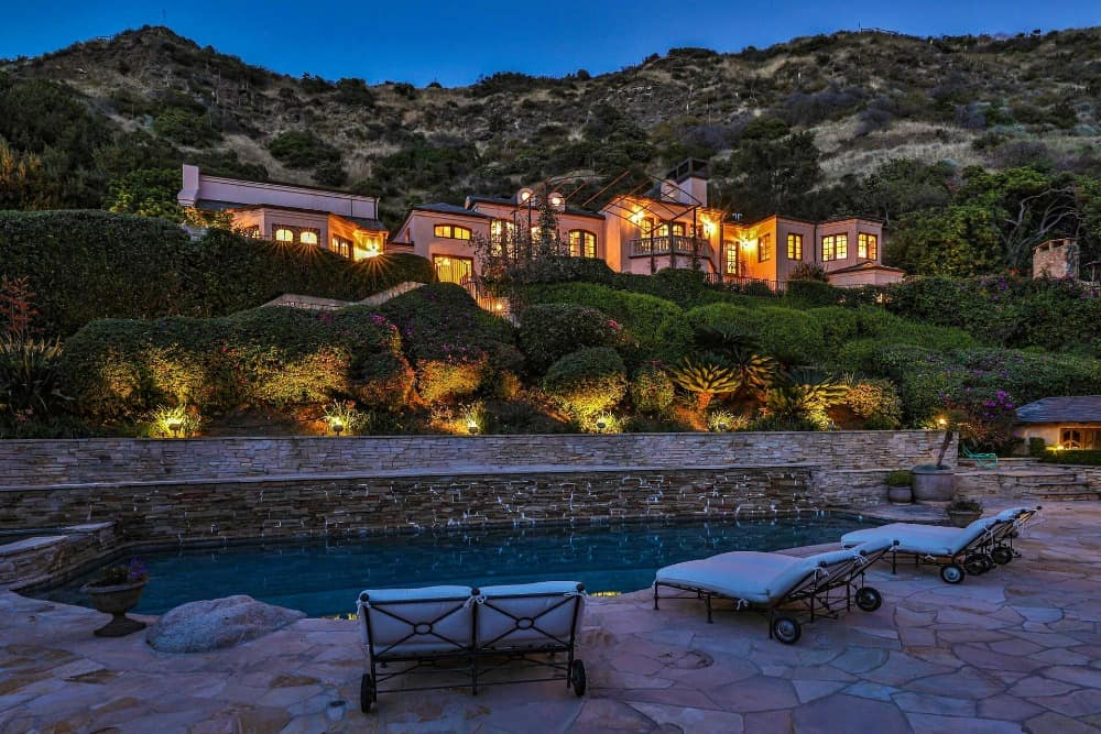 This view focuses on the house's exterior from the swimming pool area. Images courtesy of Toptenrealestatedeals.com.