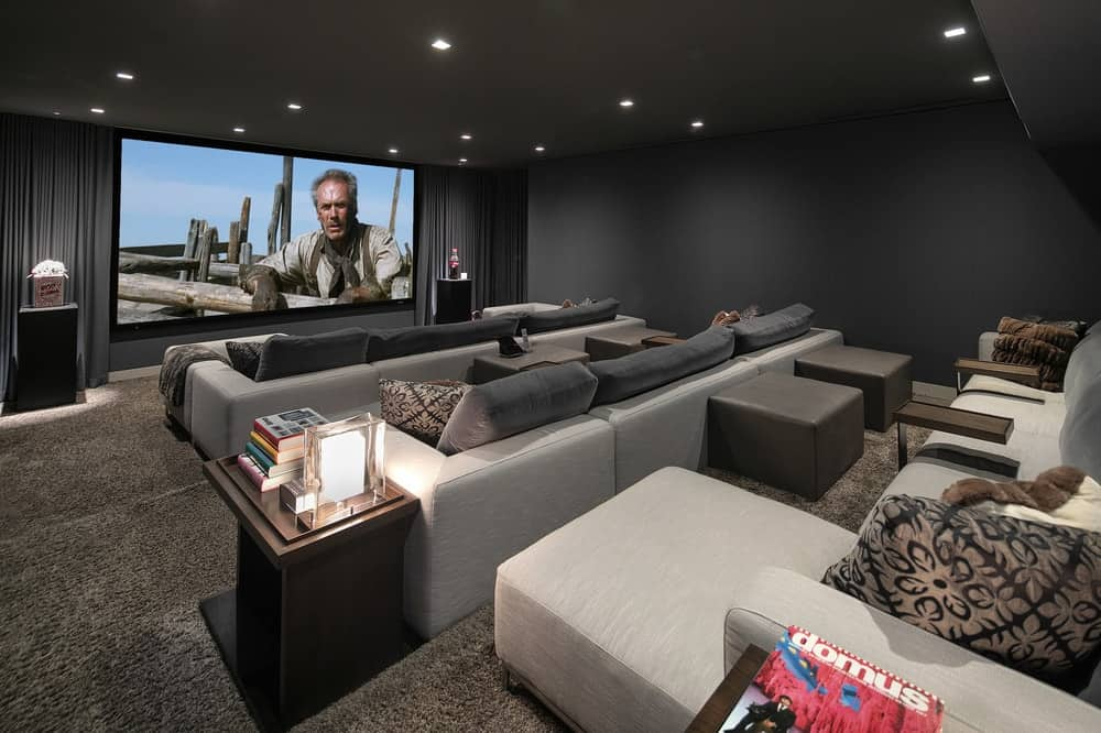 This is the immense home cinema and entertainment room of the house with a large screen at the far end paired with several pieces of sectional sofas on raise platforms for an unobstructed viewing experience. Images courtesy of Toptenrealestatedeals.com.