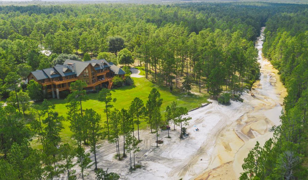 The beautiful large creek is on full display with this aerial shot of the house and features the isolation of the house with no other structures in sight. Images courtesy of Toptenrealestatedeals.com.