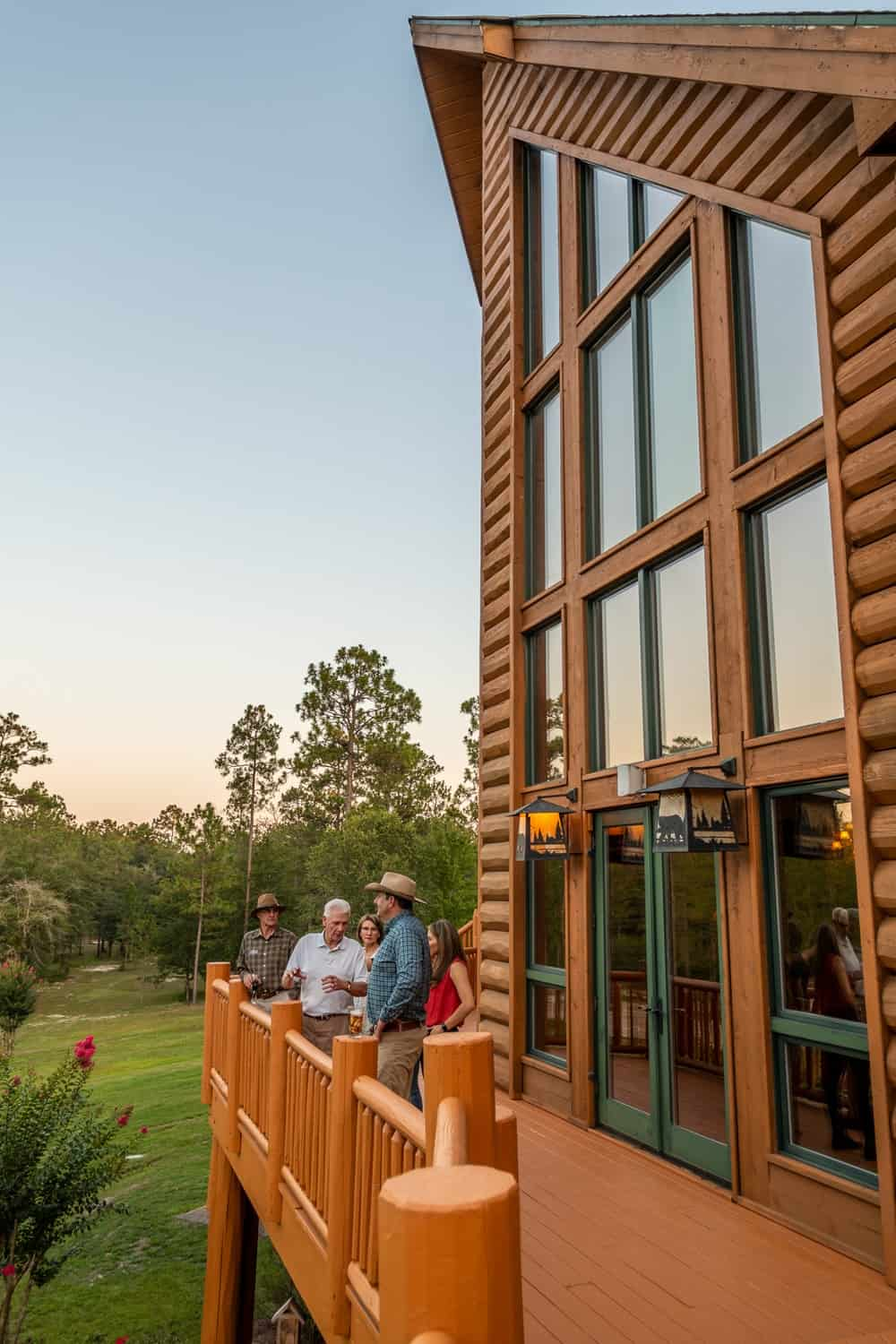 Just outside of the tall glass windows of the main hall is a large wrap-around balcony with enough space for a crowd. to enjoy the surrounding landscape scenery. Images courtesy of Toptenrealestatedeals.com.