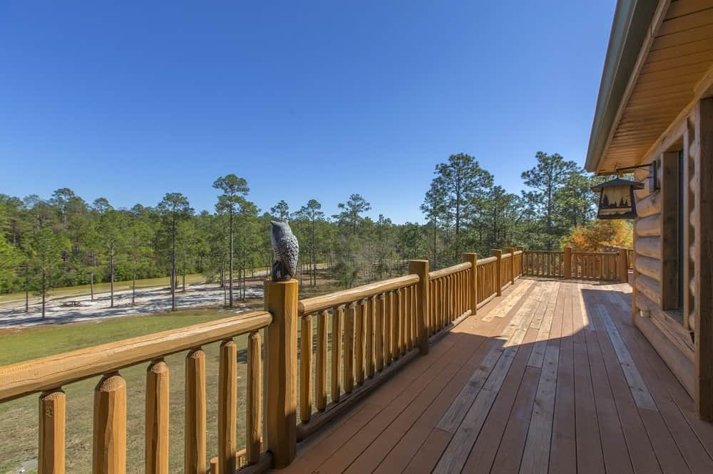 There is a view of the creek from this balcony that has gorgeous waist-high wooden railings and posts. Images courtesy of Toptenrealestatedeals.com.