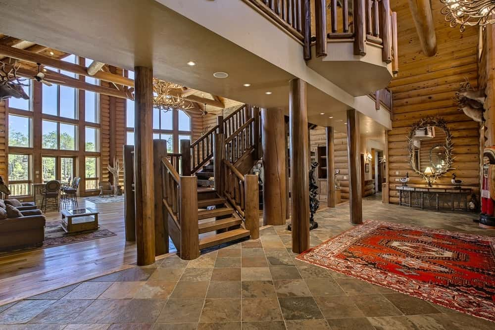 A view from the side shows that a few steps from the lovely foyer is the main staircase to the upper level with its wooden steps and banisters. Images courtesy of Toptenrealestatedeals.com.