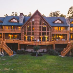 The entirety of the large log cabin is shown in this aerial shot where you can see the large hall in the middle and its two levels of gorgeous balconies. Images courtesy of Toptenrealestatedeals.com.