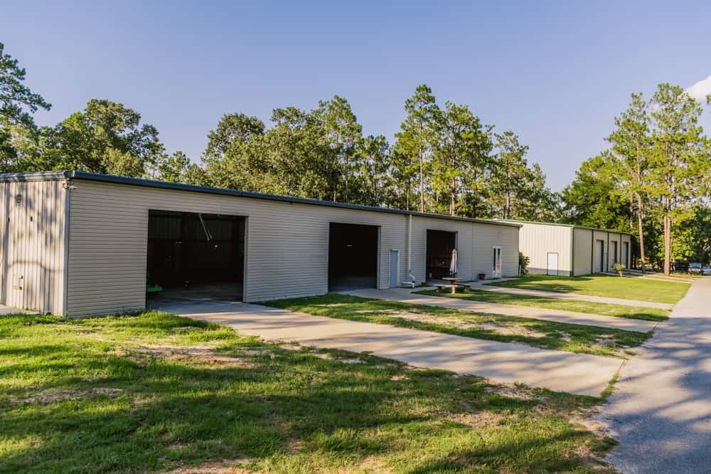 This large complex is the garage that would entice car collectors with its 22-car parking space that is also perfect for large parties. The area has lush lawns of grass and a covered garage for the cars. Images courtesy of Toptenrealestatedeals.com.