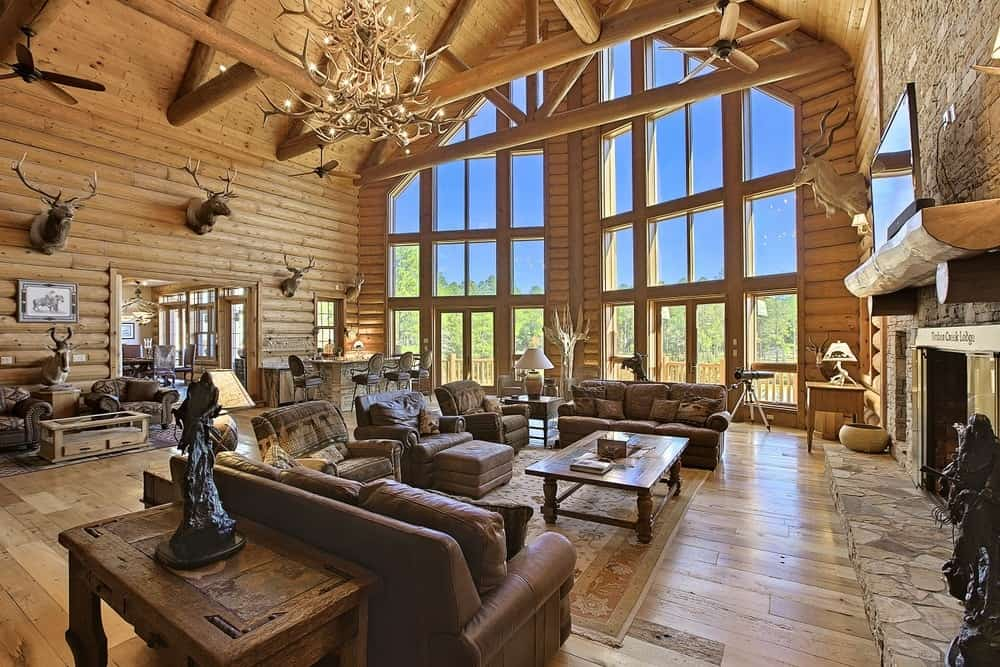 This living room is part of a large hall brightened by the tall glass windows on the far side of the hall. Images courtesy of Toptenrealestatedeals.com.