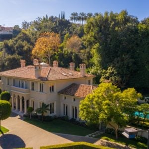 This aerial view of the mansion shows the elegant beige exterior walls of the house and the earthy tone of its roof standing out amidst the surrounding gorgeous green landscaping filled with lush lawns of grass, tall trees and on the lovely pool area surrounded by lush vegetation. Images courtesy of Toptenrealestatedeals.com.