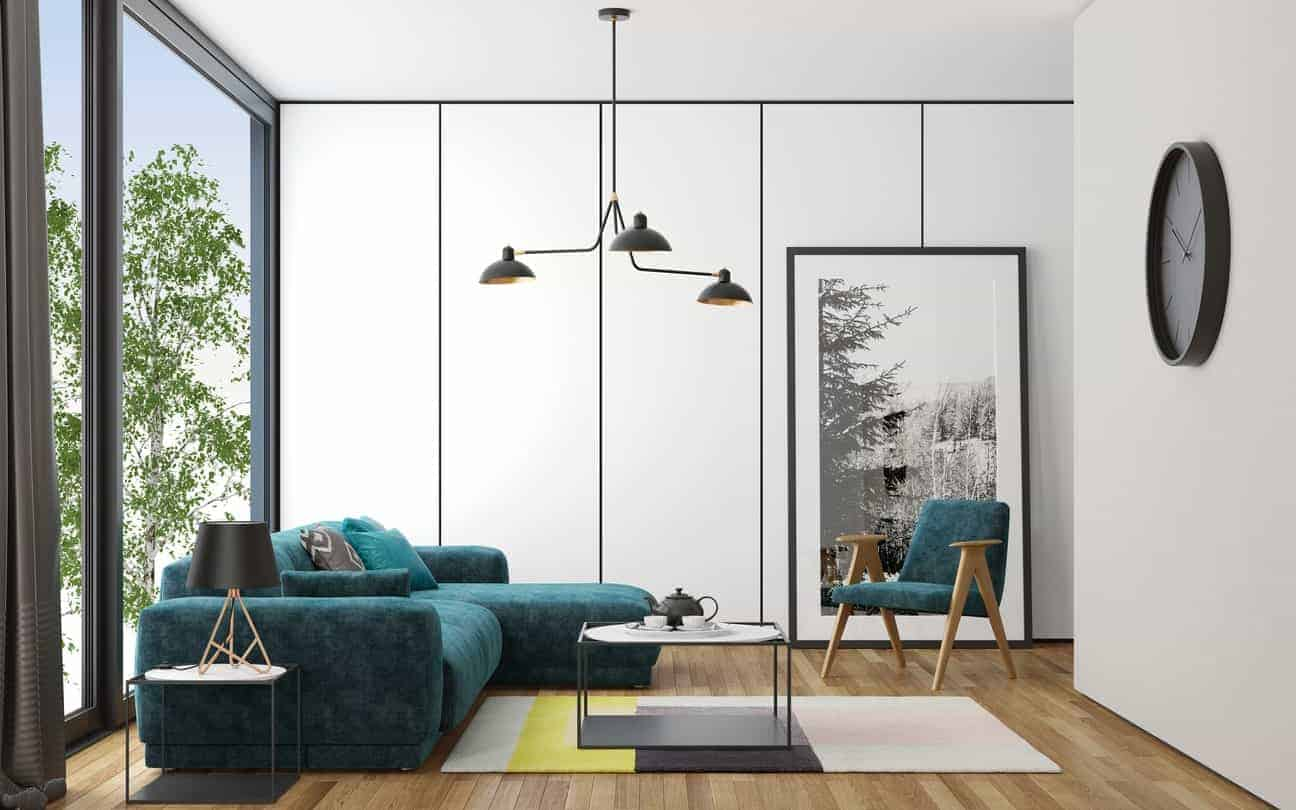 Scandinavian-Style living room boasts a modish and elegant-looking sofa set with center and side tables lighted by a pendant lighting.