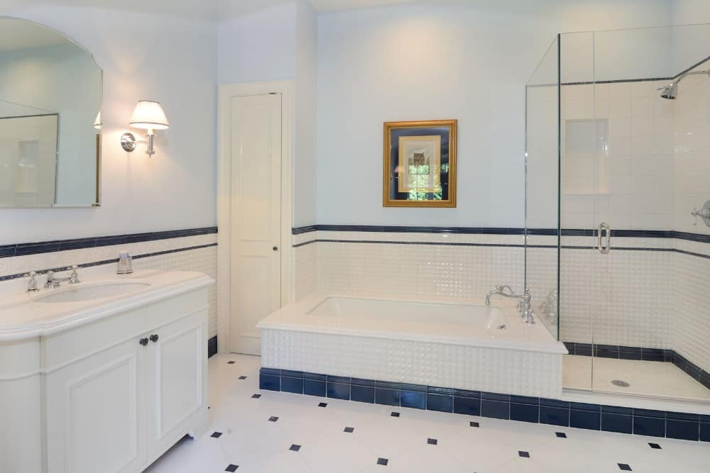 This bathroom offers a single sink counter and a drop-in tub, along with a walk-in shower room. Images courtesy of Toptenrealestatedeals.com.