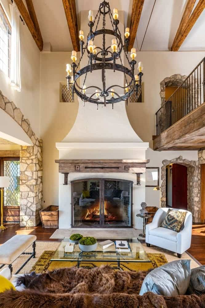 A closer look at the living space's classy fireplace lighted by a gorgeous chandelier. Images courtesy of Toptenrealestatedeals.com.