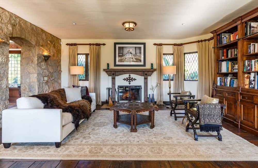 A formal living room featuring a set of elegant furniture along with a large wooden bookshelf on the side. Images courtesy of Toptenrealestatedeals.com.
