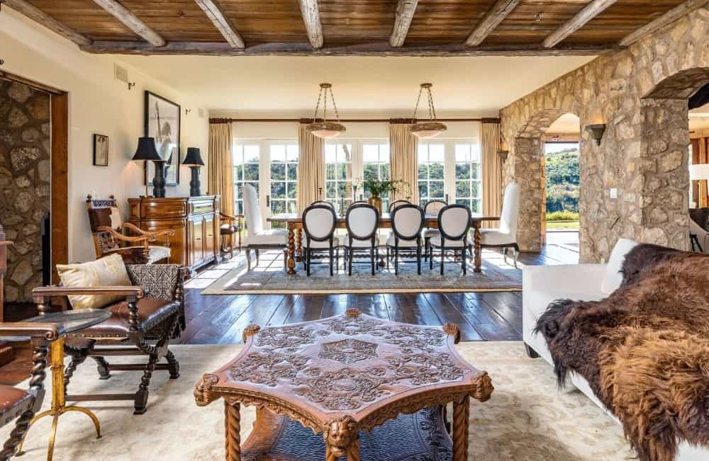 Another view at the home's great room facing the dining table set on top of a large area rug. Images courtesy of Toptenrealestatedeals.com.