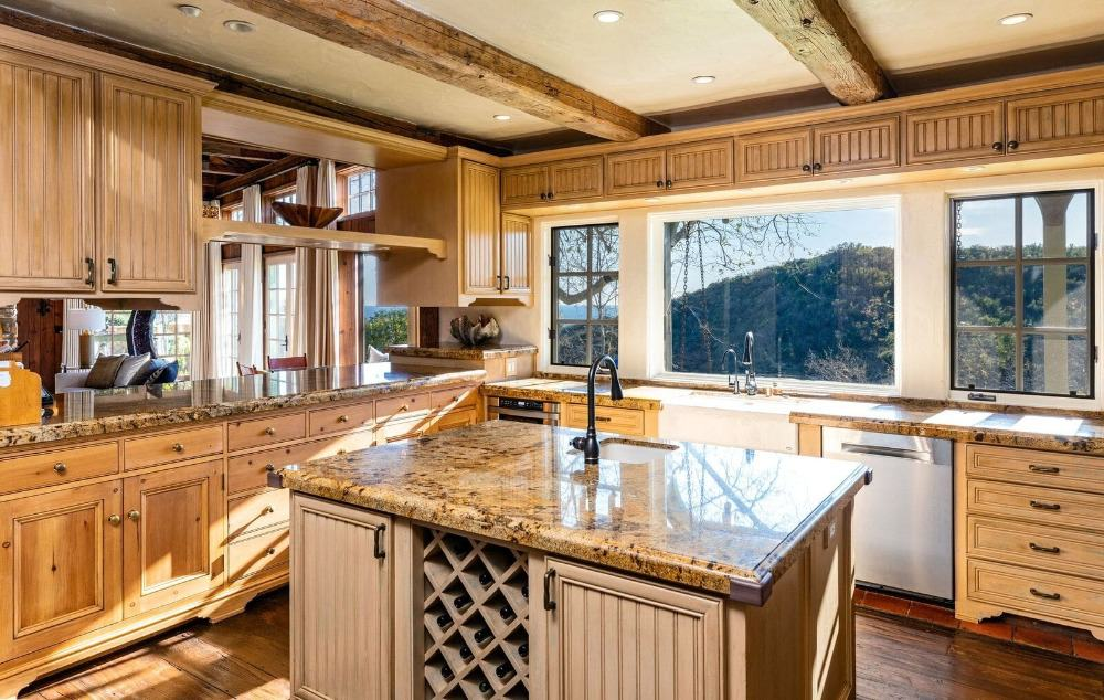 A focused look at the kitchen's center island with a countertop similar to the kitchen counter. Images courtesy of Toptenrealestatedeals.com.