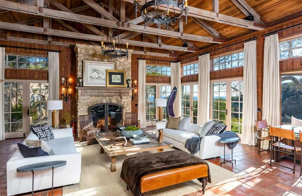 Another look at the home's large living space offering a pair of white couches and a stone fireplace. Images courtesy of Toptenrealestatedeals.com.