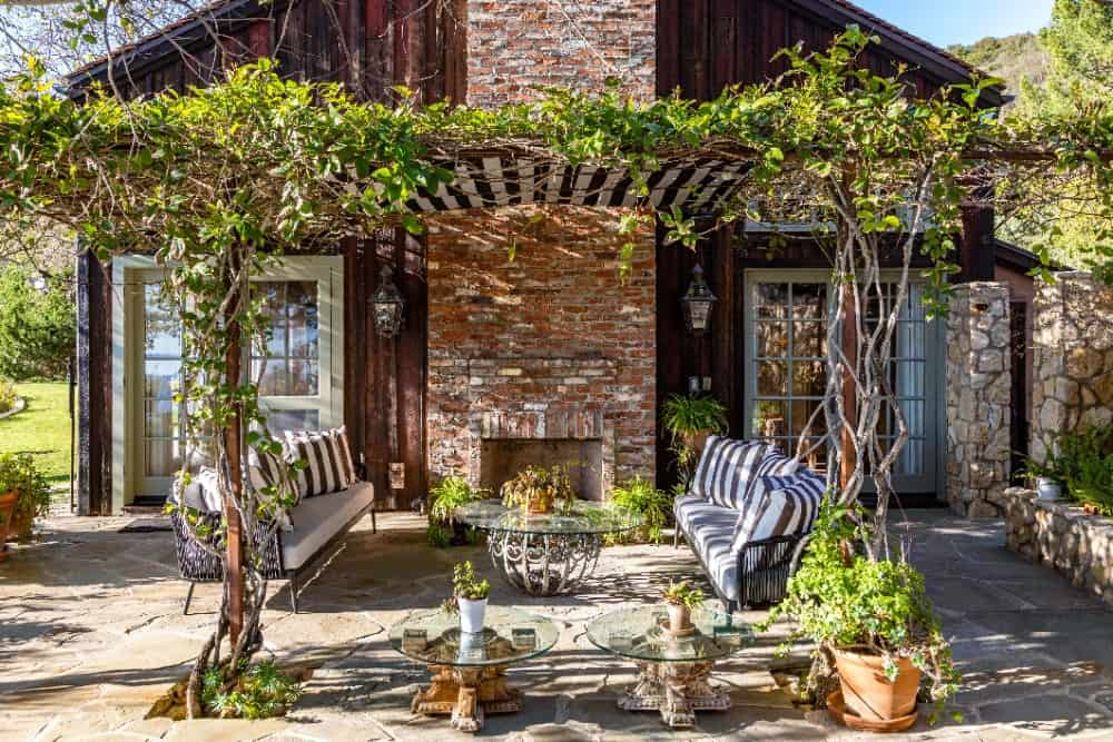 The patio offers a nice living setup along with a large stone fireplace. Images courtesy of Toptenrealestatedeals.com.