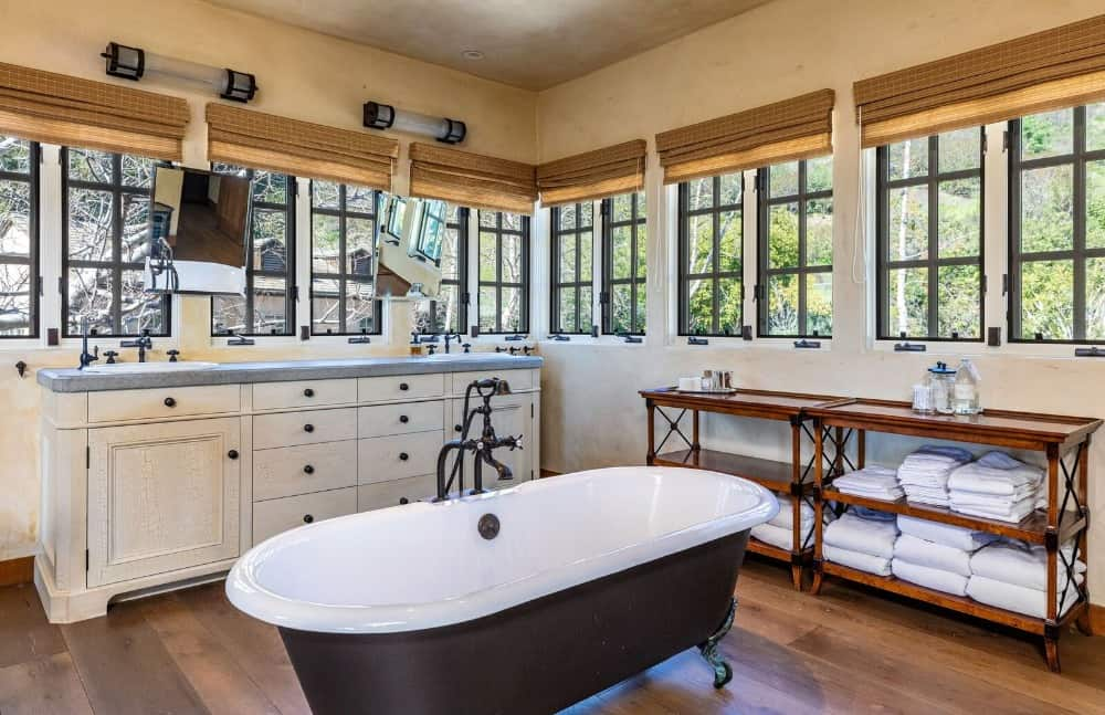Another bathroom suite featuring a double sink counter along with a freestanding tub on the center. Images courtesy of Toptenrealestatedeals.com.
