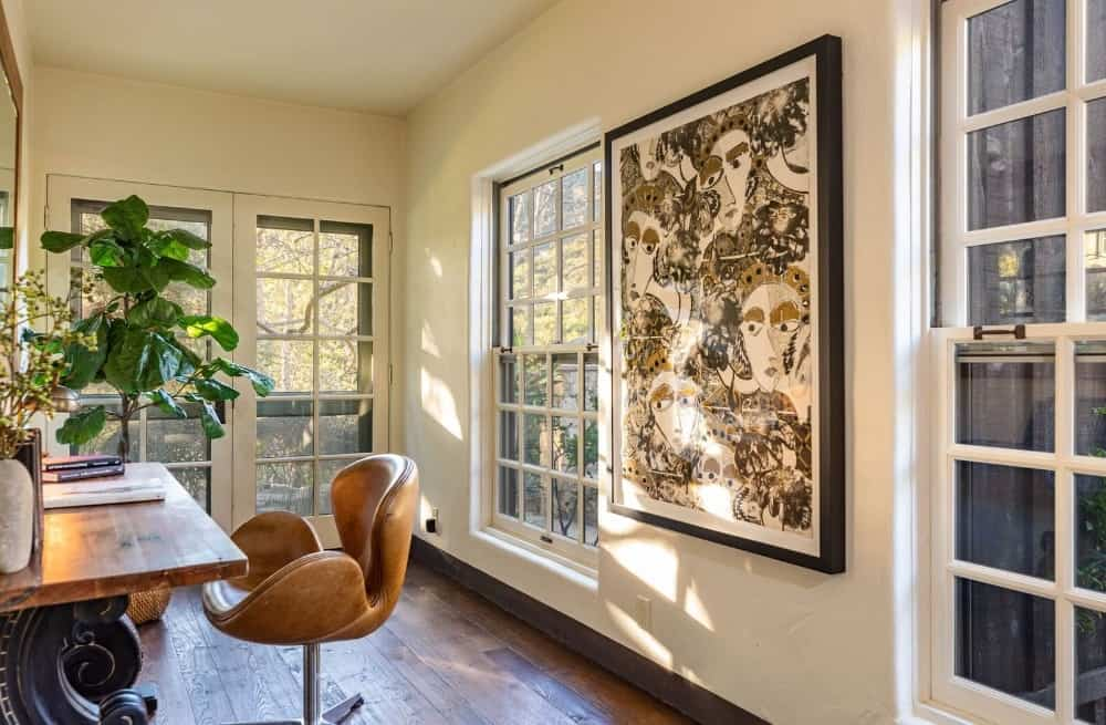 A hallway with a very artistic wall decor, which is showcased in this view. Images courtesy of Toptenrealestatedeals.com.