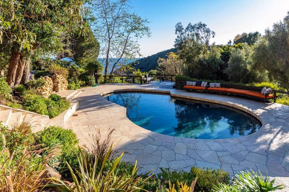 There's a kidney-shaped swimming pool in the backyard as well. Images courtesy of Toptenrealestatedeals.com.