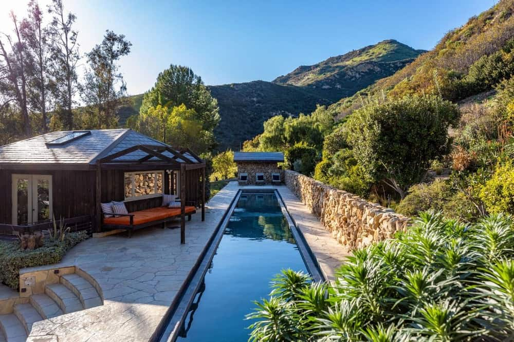 The other swimming pool is a long rectangular one with a greenery on the side. Images courtesy of Toptenrealestatedeals.com.