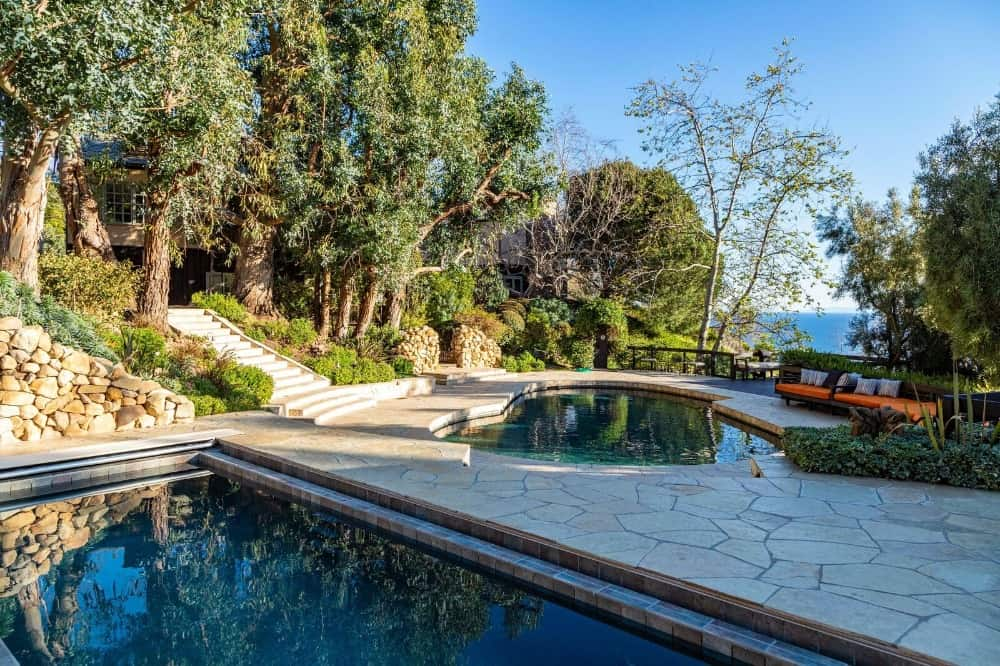 Here's a view of the swimming pool area featuring a long rectangular one and a kidney-shaped one. Images courtesy of Toptenrealestatedeals.com.