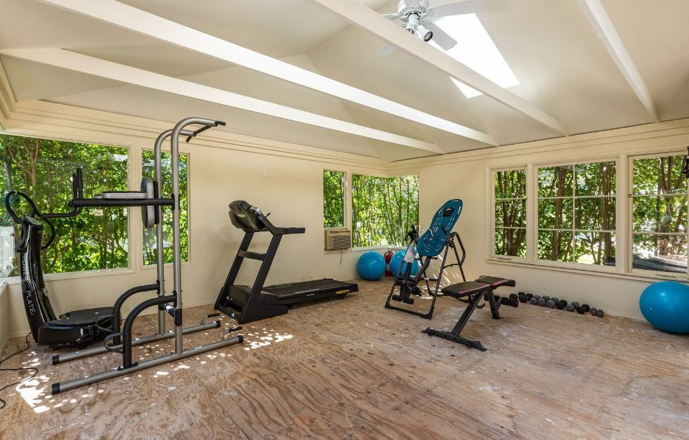 The home also has a spacious home gym with gorgeous carpet flooring. Images courtesy of Toptenrealestatedeals.com.