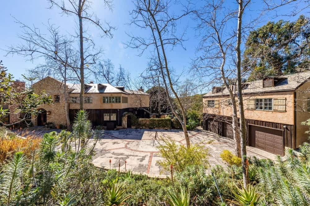 Aerial view of the home's three-car garage with a wide and gorgeous driveway. Images courtesy of Toptenrealestatedeals.com.