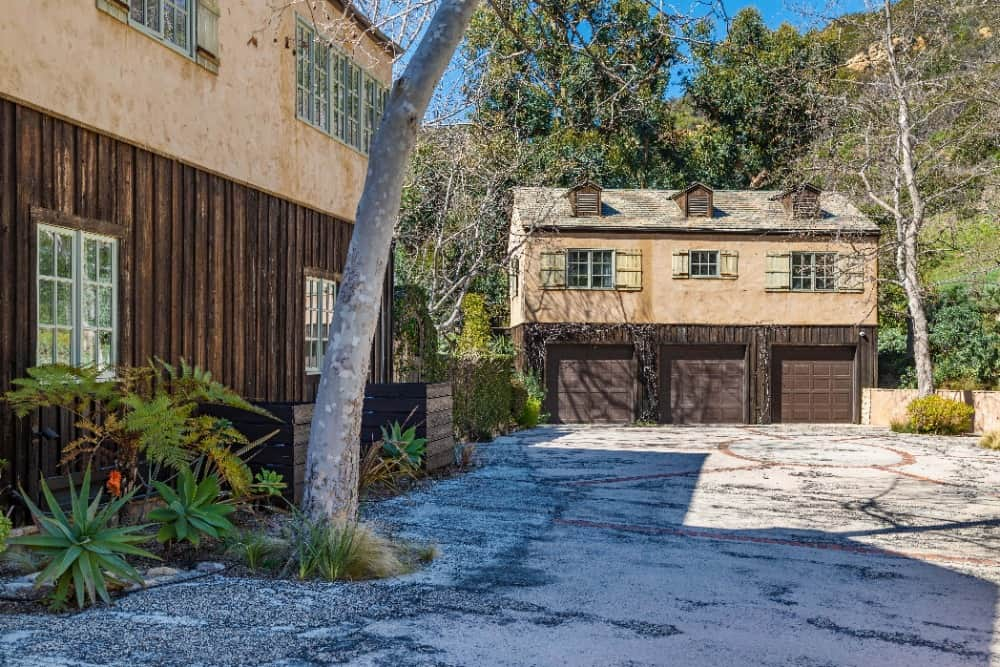 The home also offers a three-car garage with a wide driveway. Images courtesy of Toptenrealestatedeals.com.