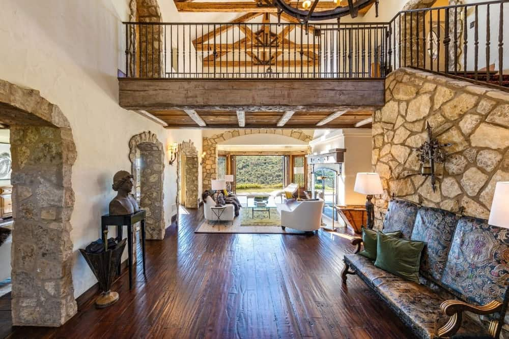 The entry hall of the house looks absolutely elegant with its hardwood floors and a high ceiling with exposed wooden beams. Images courtesy of Toptenrealestatedeals.com.