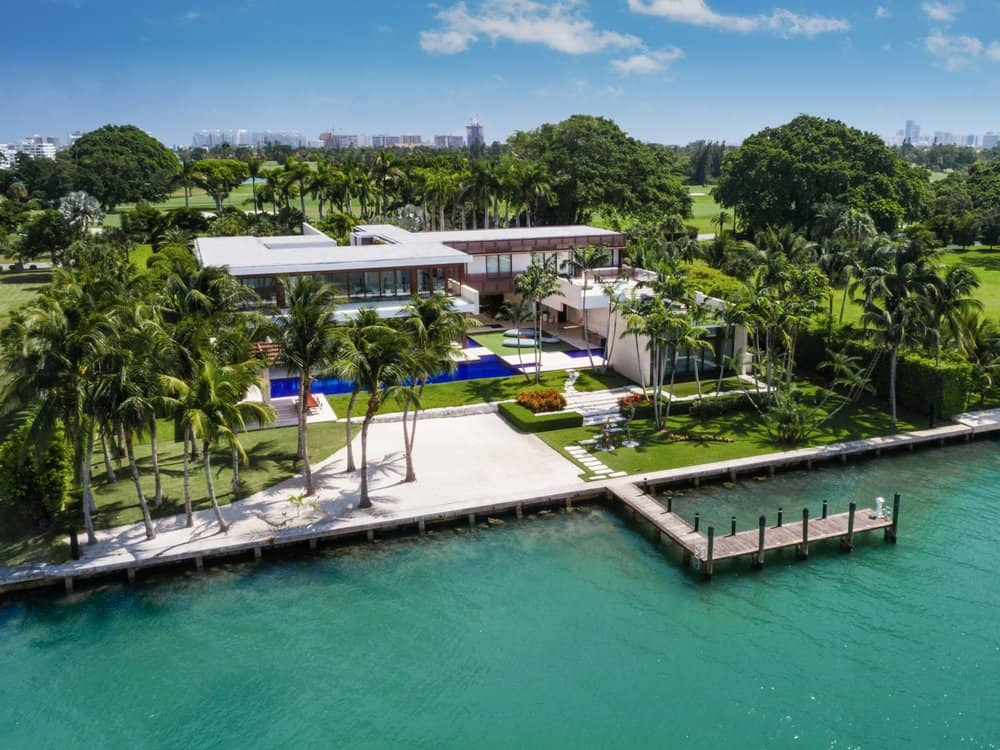 This aerial view of the entire property shows the luxurious home in all its glory. The second level of the large home mostly has glass walls for a perfect view of the ocean beyond the property that has its own boat dock. Images courtesy of Toptenrealestatedeals.com.