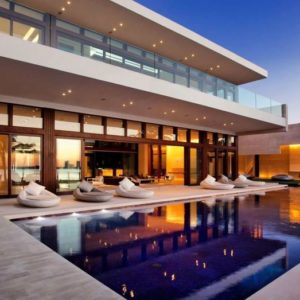 This luxurious home has a gorgeous swimming pool at the backyard. Most of the walls of the house are made glass to take maximum advantage of the surrounding beach views and the beautiful backyard pool. Images courtesy of Toptenrealestatedeals.com.