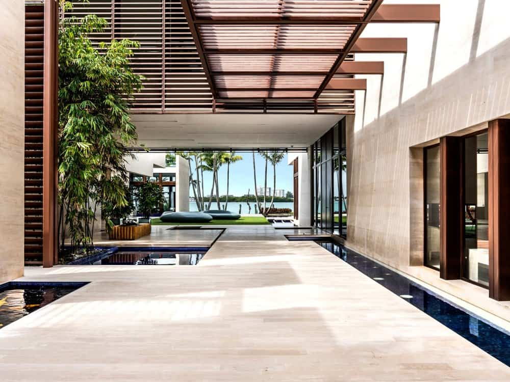 The house has a lot of open areas that can serve as one big foyer with an unobstructed view of the beach front on the far end. There are wide marble walkways and gorgeous indoor landscaping. Images courtesy of Toptenrealestatedeals.com.