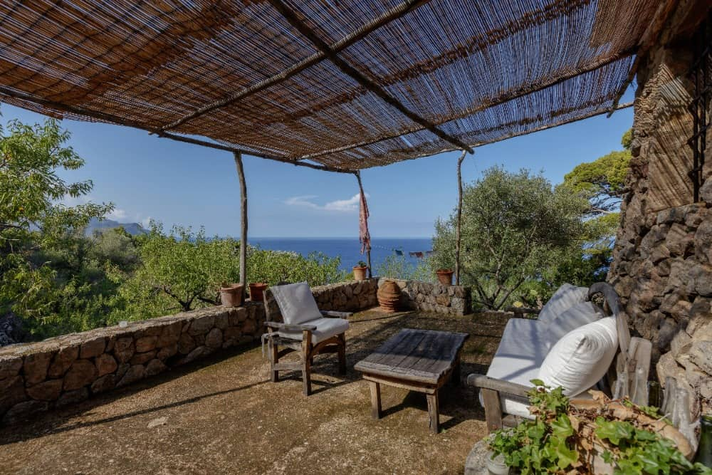 This balcony area boasts a gorgeous view of the surroundings. Images courtesy of Toptenrealestatedeals.com.