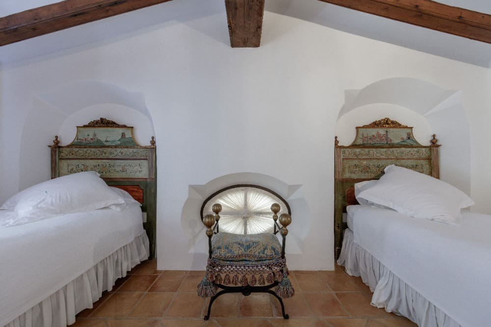 This guests bedroom offers two single beds with beautiful bed frames. Images courtesy of Toptenrealestatedeals.com.