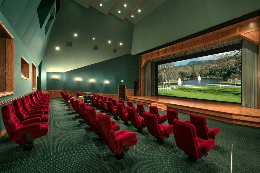 The house also offers a massive home theater with multiple sectional red seats surrounded by green walls, green carpet flooring and a green ceiling. Images courtesy of Toptenrealestatedeals.com.