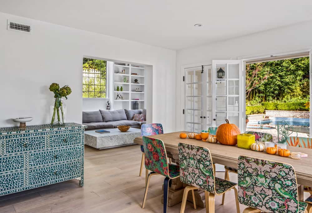 There is also a matching colorful patterned dining room cabinet on the side against the wall and there is a clear view of the family on the far side through an open wall entry. Images courtesy of Toptenrealestatedeals.com.
