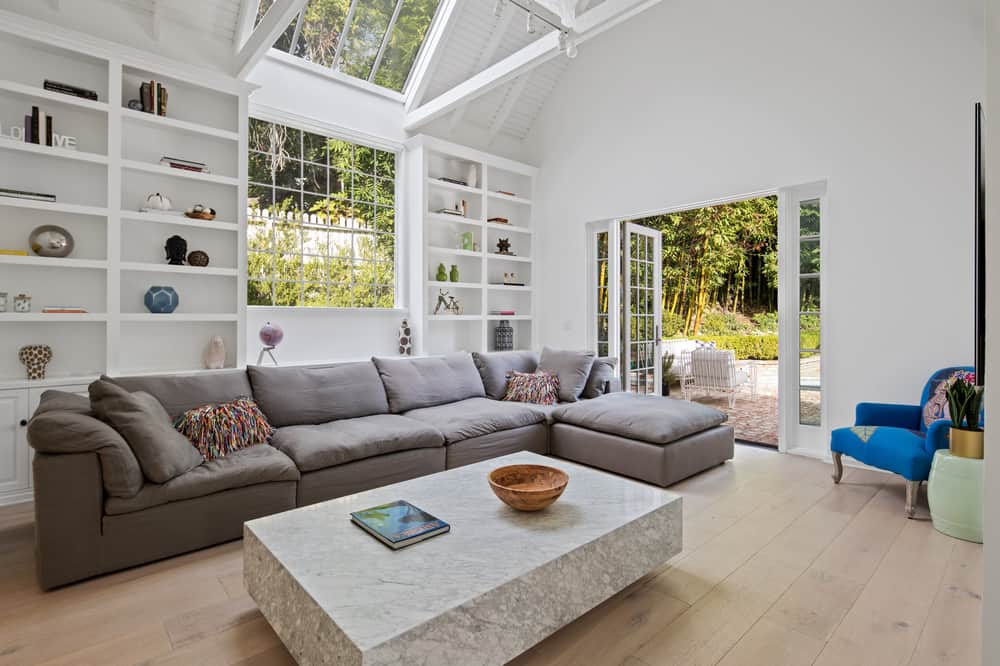 This is the family room just a few steps from the dining room. It has a sun roof and wide windows to maximize the natural lighting and brighten up the gray L-shaped sectional sofa paired with a large rectangular coffee table. Images courtesy of Toptenrealestatedeals.com.