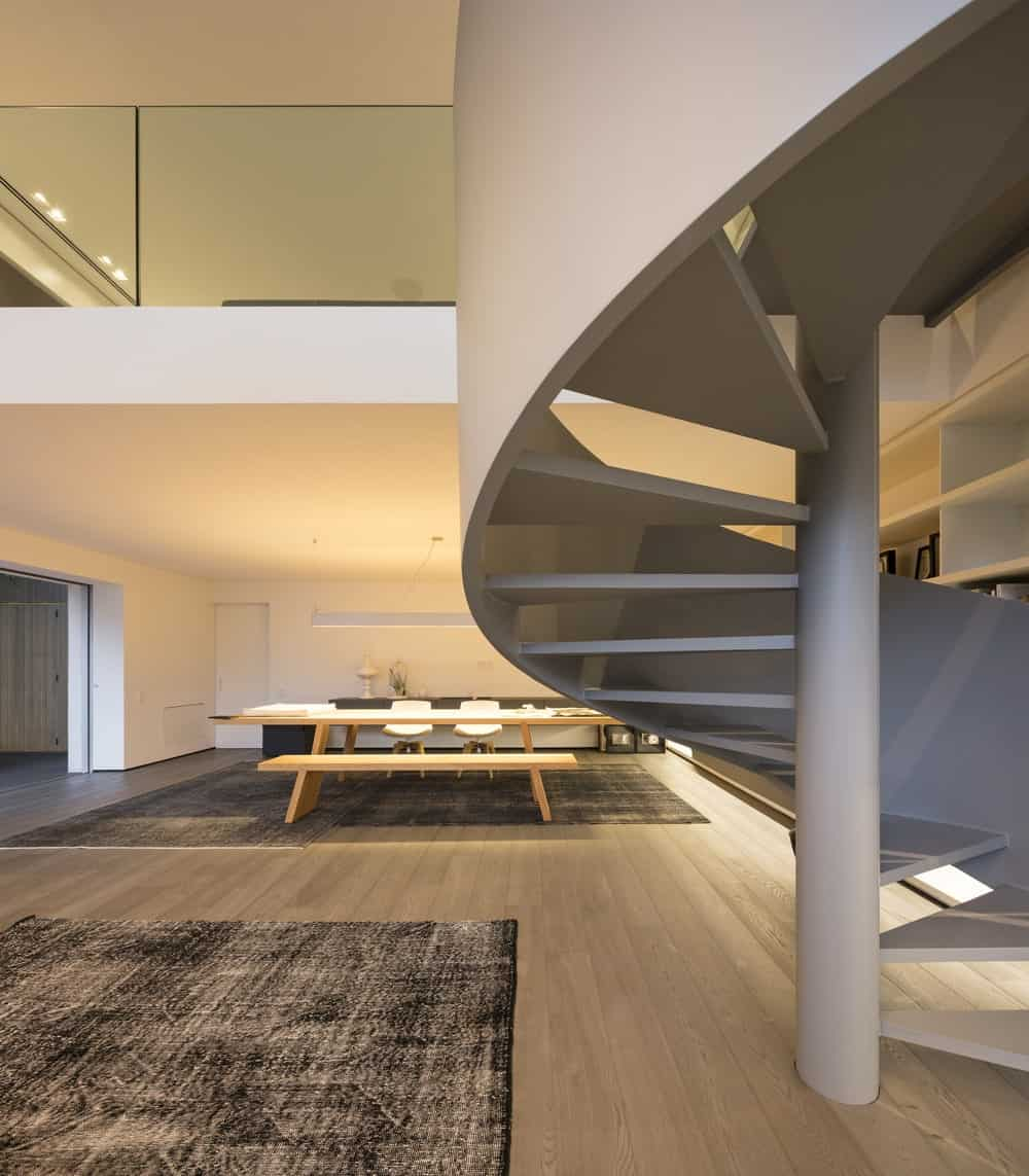 Workspace behind the spiral staircase in the Gama Issa v2.0 designed by studio mk27.
