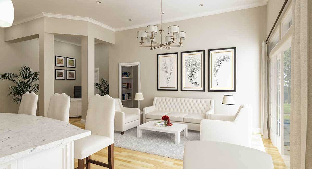 The living area has sleek furniture and simple artworks adorning the light gray walls.