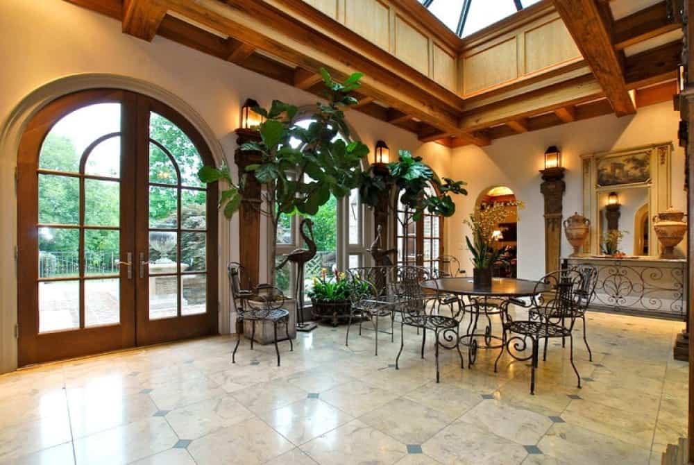 This dining nook is near the home's entryway. It features a classy round table paired with classy chairs. Images courtesy of Toptenrealestatedeals.com.